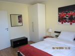 Feriennwohnung Freising Gästezimmer mit Schrank, Kofferablage